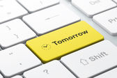Time concept: Clock and Tomorrow on computer keyboard background — Stock Photo