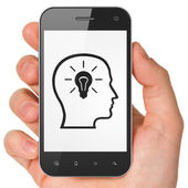 Advertising concept: Head Whis Lightbulb on smartphone — Foto Stock