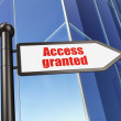 Security concept: Access Granted on Building background — Stock Photo #25370687