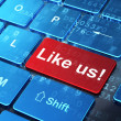 Social network concept: Like us! on computer keyboard background — Stock Photo #25393243