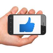 Social media concept: Like on smartphone — Stock Photo