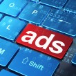 Стоковое фото: Advertising concept: Ads on computer keyboard background