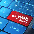 Web design concept: Gears and Web Hosting on computer keyboard b — Stock Photo