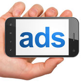Advertising concept: Ads on smartphone — Stock Photo