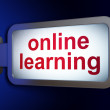 Foto Stock: Education concept: Online Learning on billboard background