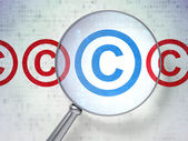 Law concept: Copyright with optical glass on digital background — Stock Photo
