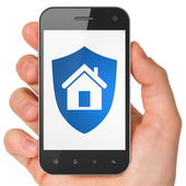 Privacy concept: Shield on smartphone — Stock Photo