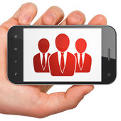 Advertising concept: Business on smartphone — Stock Photo