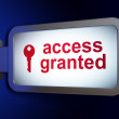 Stock Photo: Security concept: Access Granted and Key on billboard background