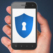 Safety concept: Shield With Keyhole on smartphone — Zdjęcie stockowe