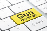 Privacy concept: Gun Control on computer keyboard background — Stockfoto