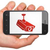 Güvenlik kavramı: Cctv kamera smartphone cep telefonu ile — Stok fotoğraf
