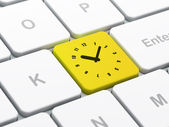 Time concept: Clock on computer keyboard background — Stok fotoğraf