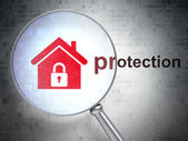 Protection concept: Home and Protection with optical glass — Stock Photo