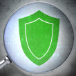 Stock Photo: Privacy concept: Shield with optical glass on digital backgroun
