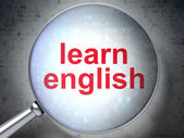 Education concept: Learn English with optical glass — Stock Photo