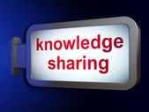 Education concept: Knowledge Sharing on billboard background — Stock Photo