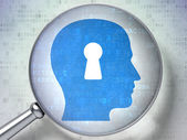 Security concept: Head With Keyhole with optical glass on digit — Stock Photo