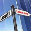 Education concept: Learn and Lead! on Building background — Stok fotoğraf