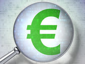 Currency concept: Euro with optical glass on digital background — Stockfoto