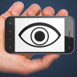 Privacy concept: Eye on smartphone — Stock Photo