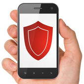 Safety concept: Shield on smartphone — Stock Photo