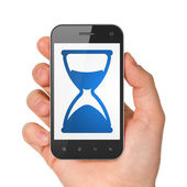 Timeline concept: Hourglass on smartphone — Stok fotoğraf
