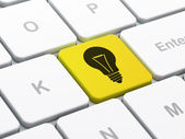 Business concept: Light Bulb on computer keyboard background — Stock Photo