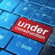 Web development concept: Under Construction on computer keyboard — Stock Photo