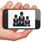 Zákon koncept: obchodní tým na smartphone — Stock fotografie