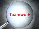 Finance concept: Teamwork with optical glass — Stock Photo