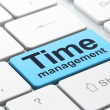 Stock Photo: Time concept: Time Management on computer keyboard background