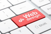 Web development concept: Gears and Web Design on computer keyboa — Stock Photo