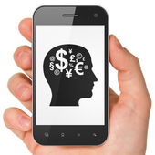 Finance concept: Head With Finance Symbol on smartphone — Zdjęcie stockowe