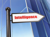 Education concept: Intelligence on Building background — Stockfoto