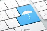 Privacy concept: Umbrella on computer keyboard background — Stok fotoğraf