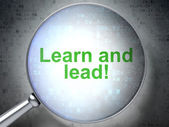 Education concept: Learn and Lead! with optical glass — Stock Photo