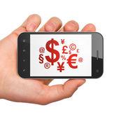 マーケティング ・ コンセプト: スマート フォンに財務の記号 — ストック写真