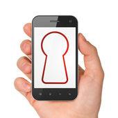 Data concept: Keyhole on smartphone — Stock Photo