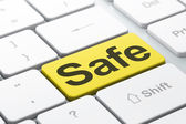 Security concept: Safe on computer keyboard background — Stok fotoğraf
