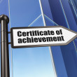 Education concept: Certificate of Achievement on Building backgr — Stock Photo