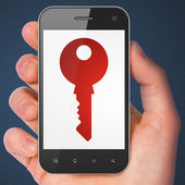 Security concept: Key on smartphone — Stock Photo