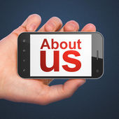 Marketing concept: About Us on smartphone — Stock Photo