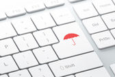 Protection concept: Umbrella on computer keyboard background — Foto de Stock