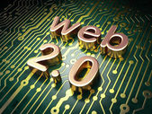 SEO web development concept: Web 2.0 on circuit board background — Стоковое фото