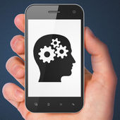 Advertising concept: Head With Gears on smartphone — 图库照片