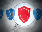Security concept: Shield with optical glass on digital backgroun — Stock Photo