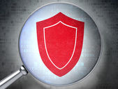 Protection concept: Shield with optical glass on digital backgr — Stock Photo