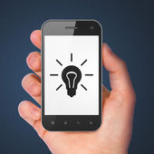 Business concept: Light Bulb on smartphone — Stock Photo