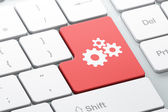 Web development concept: Gears on computer keyboard background — Stock Photo